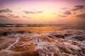 Sunset at tropical beach ocean sandy coast under evening sun south india landscape Royalty Free Stock Images