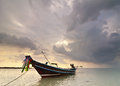 Sunset at tropical beach with thai fishing boat evening ocean landscape traditional under dramatic stormy sky thailand koh samui Stock Photo