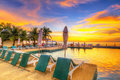 Sunset at tropical swimming pool Royalty Free Stock Photo