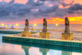 Sunset at tropical swimming pool in thailand Stock Photography