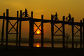 Sunset at u ben bridge with myanmar people amarapura mandalay uben on Stock Images