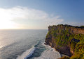 Sunset at uluwatu temple on top of big cliffs is one the main tourist attractions bali indonesia Stock Images