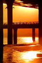 At sunset under the viaduct on beach bottom of Royalty Free Stock Image