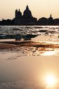 Sunset in Venice - Reflection of the Madonna della Salute church Royalty Free Stock Photo