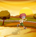 A sunset view with a boy running Royalty Free Stock Photo