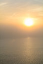Sunset view from the deck of a boat horizontal view of a foggy sun setting background early in evening Royalty Free Stock Image