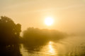 Sunset view from the deck of a boat horizontal view of a foggy sun setting background early in evening Royalty Free Stock Photos