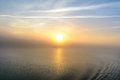 Sunset view from the deck of a boat horizontal view of a foggy sun setting background early in evening Stock Images