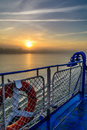 Sunset view from the edge of a boat s deck vertical view of a f foggy sun setting background in summer evening Stock Photo
