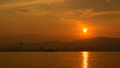 Sunset view of penang island and fisherboat from the beach during Royalty Free Stock Image