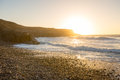 Sunset at the west coast of fuerteventura spain a gravel beach Royalty Free Stock Images