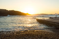 Sunset at the west coast of fuerteventura spain a gravel beach Stock Photography