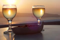 Sunset with Wine and Peanuts Stock Images