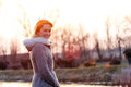 Sunset woman young smiling at in winter in the netherlands Stock Photos