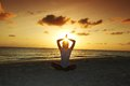Sunset yoga woman Stock Images