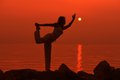 Sunset yoga woman doing yoga exercise beach sunset Stock Photography