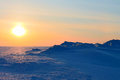 Sunsets on the snow island Royalty Free Stock Photography