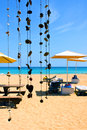 Sunshade at the beach in island of sal in archipelago of cape verde white sand and clear blue water Royalty Free Stock Photo