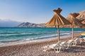 Sunshade and deck chair on beach at Baska in Krk Croatia Stock Photos