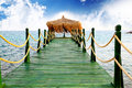 Sunshade on a pier on the sea Royalty Free Stock Photo