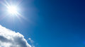 Sunshine against blue sky Royalty Free Stock Photo