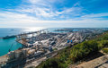 Sunshine on Balearic sea & Barcelona industrial shipping and rail ports on a blue-sky sunny day. Royalty Free Stock Photo