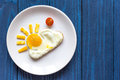 Sunshine fried eggs breakfast for kid on blue background Royalty Free Stock Photo