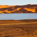 Sunshine in the lake yellow desert of morocco sand and dune Stock Images