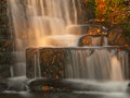 Sunshine over a waterfall in the autumn Stock Image