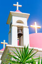 Sunshine ray reflection in golden crosses on pink domes Royalty Free Stock Photo