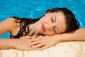 Sunshine relaxation relaxed young woman enjoying the on a hot day at the swimming pool Royalty Free Stock Photo