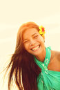 Sunshine smiling summer girl laughing happy looking at camera enjoying the summer sun sunset during holidays vacation young woman Stock Photography