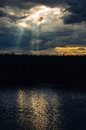 Sunshine through storm clouds Royalty Free Stock Photo