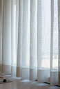 sunshire light looking pass Translucent white fabric curtains an Royalty Free Stock Photo