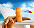 Suntan lotion on chair at the  beach Royalty Free Stock Images