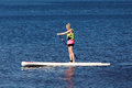 SUP fitness - woman on paddle board in the lake Royalty Free Stock Photo