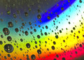 Super Bright Intense Rainbow Water Drop Background Stock Photo