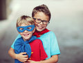 Super brothers portrait of two little cheerful superheroes Royalty Free Stock Image