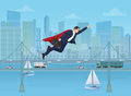 Super businessman dressed as a super hero flying over modern city landscape background. Royalty Free Stock Photo