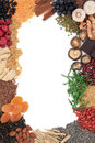 Super food selection forming an abstract border over white background Stock Photo