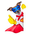 Super hero dog with red cape and a blue mask beside a blank banner Royalty Free Stock Image