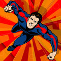 Super hero flying with abstract background Stock Images