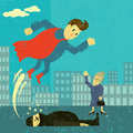 Super hero saves the day a an elderly woman from a thief Stock Photography