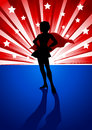 Super heroine silhouette illustration of a standing in front of light burst Stock Photos