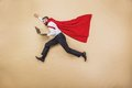 Super manager with coat of superman superhero in studio Royalty Free Stock Images