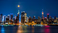 Super Moon above New York skyline. Royalty Free Stock Photo