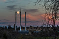 Super moon bend oregon the rises above the smokestacks in Royalty Free Stock Photo