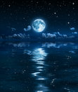 Super moon and clouds in the night on sea sky dream of a calm clear Stock Photo