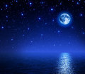Super moon in starry sky on sea romantic scene the night background Stock Photos
