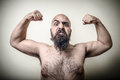 Super power angry muscle bearded man on gray background Royalty Free Stock Photo